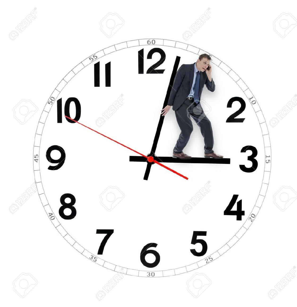 Businessman saving time holding the clock Stock Photo - 19692768