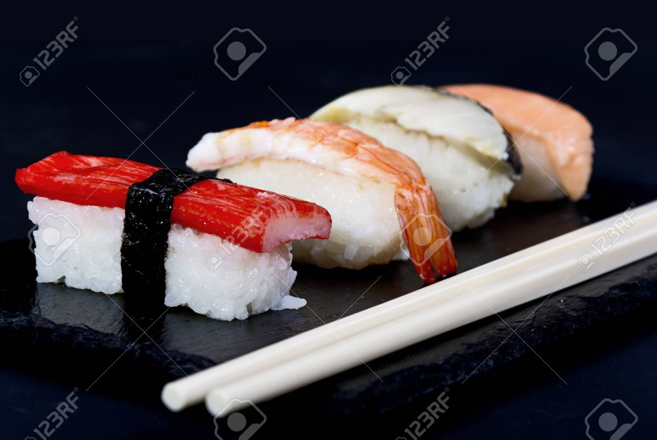 Sushi with chopsticks on black plate Stock Photo - 20875720