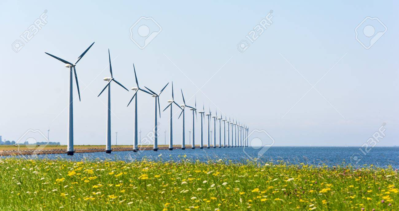 Wind energy windmills near grassland and sea shore Stock Photo - 21077616