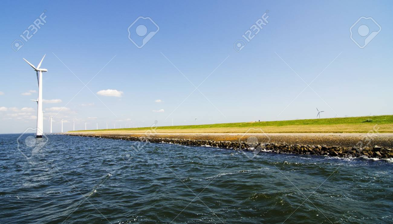 Alternative energy by windmills near water Stock Photo - 21695212