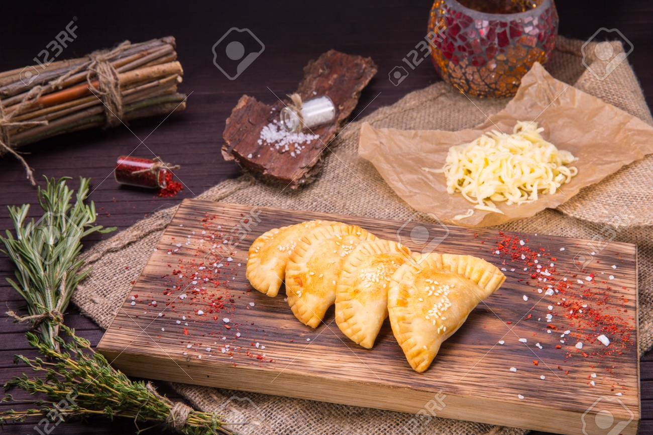 the arab home-made pies in hot fan, with cheese and sesame powder