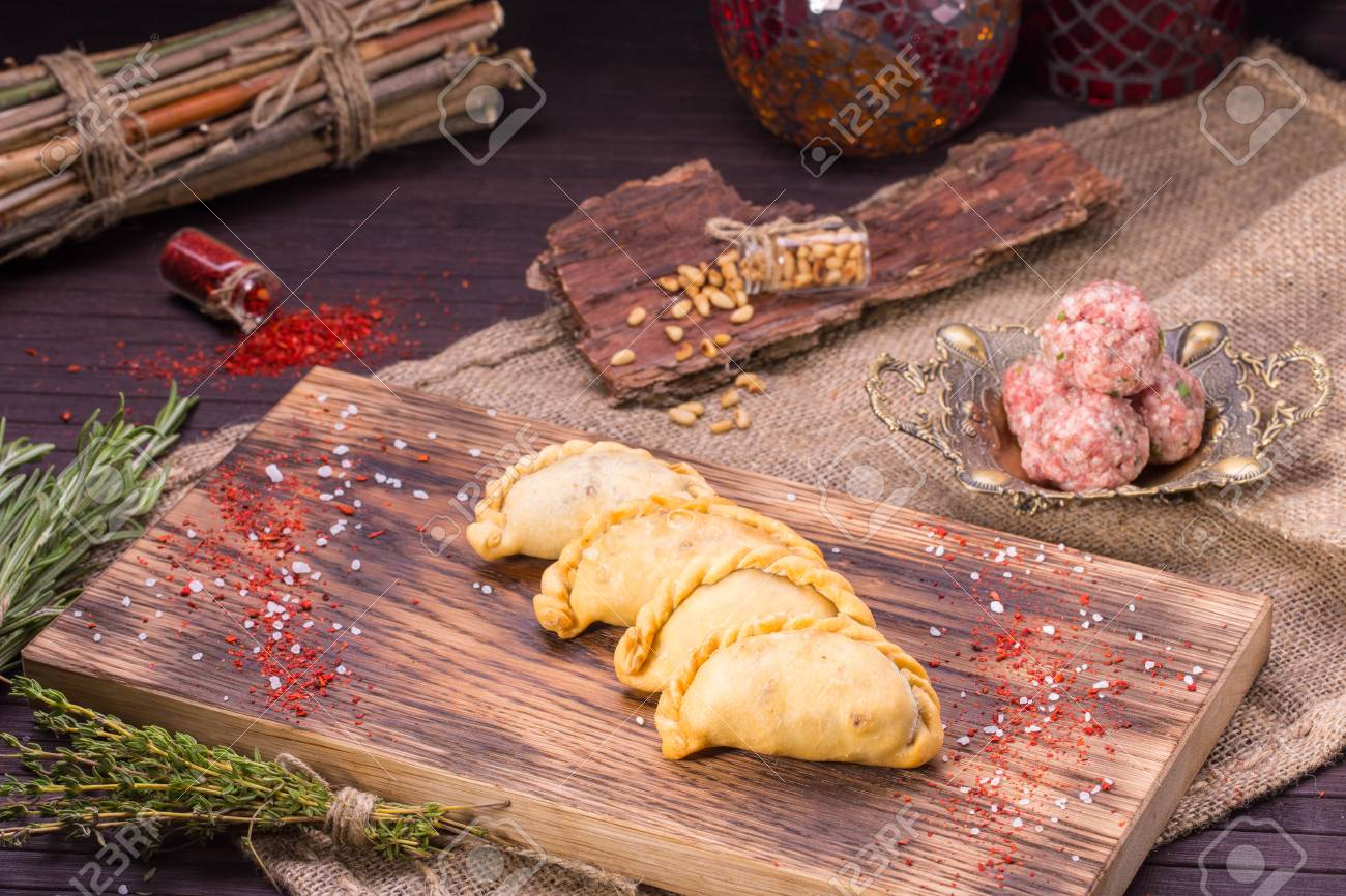 arab home-made mutton forcemeat and pine nuts pies stock photo