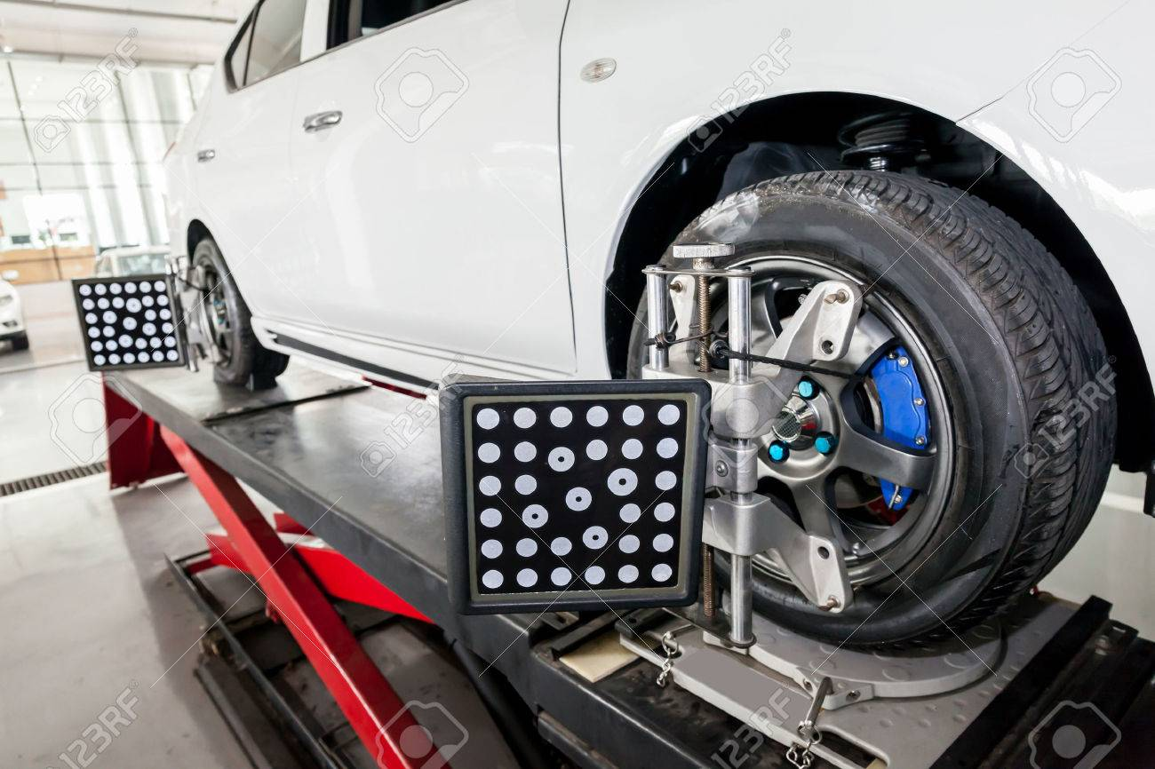 suspension adjustment and automobile wheel alignment work being