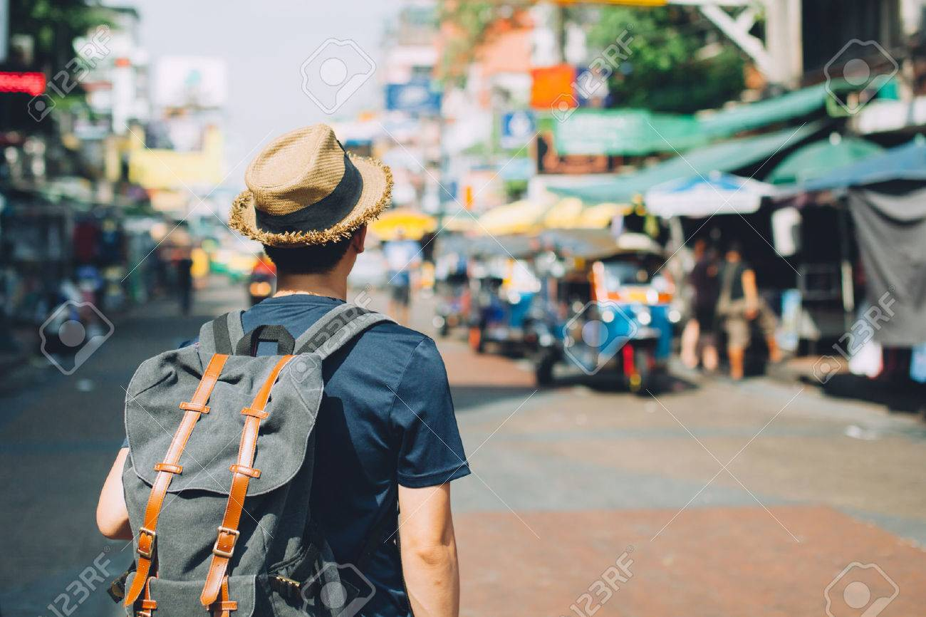 Young Asian traveling backpacker in Khaosan Road outdoor market in Bangkok, Thailand Stock Photo - 70343317
