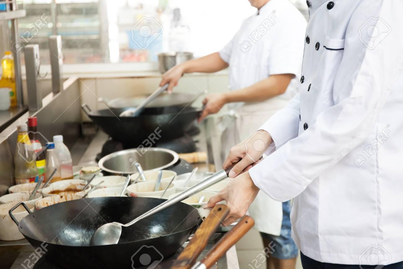 busy restaurant kitchen. Group Of Chefs In Hotel Or Restaurant Kitchen Busy Cooking Stock Photo - 72191111
