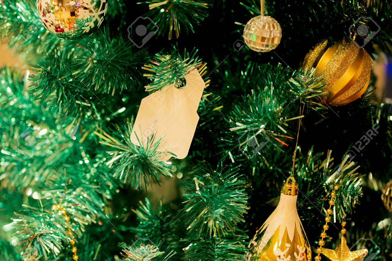 Christmas Tree Decorated With Beautiful Golden Ornaments And Stock