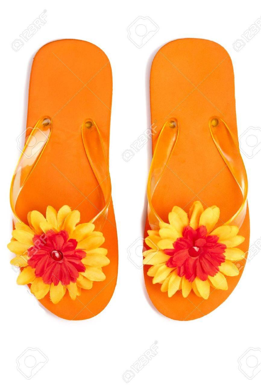 75e64fd29da2 orange flip-flops with flowers on a white background Stock Photo - 9216504