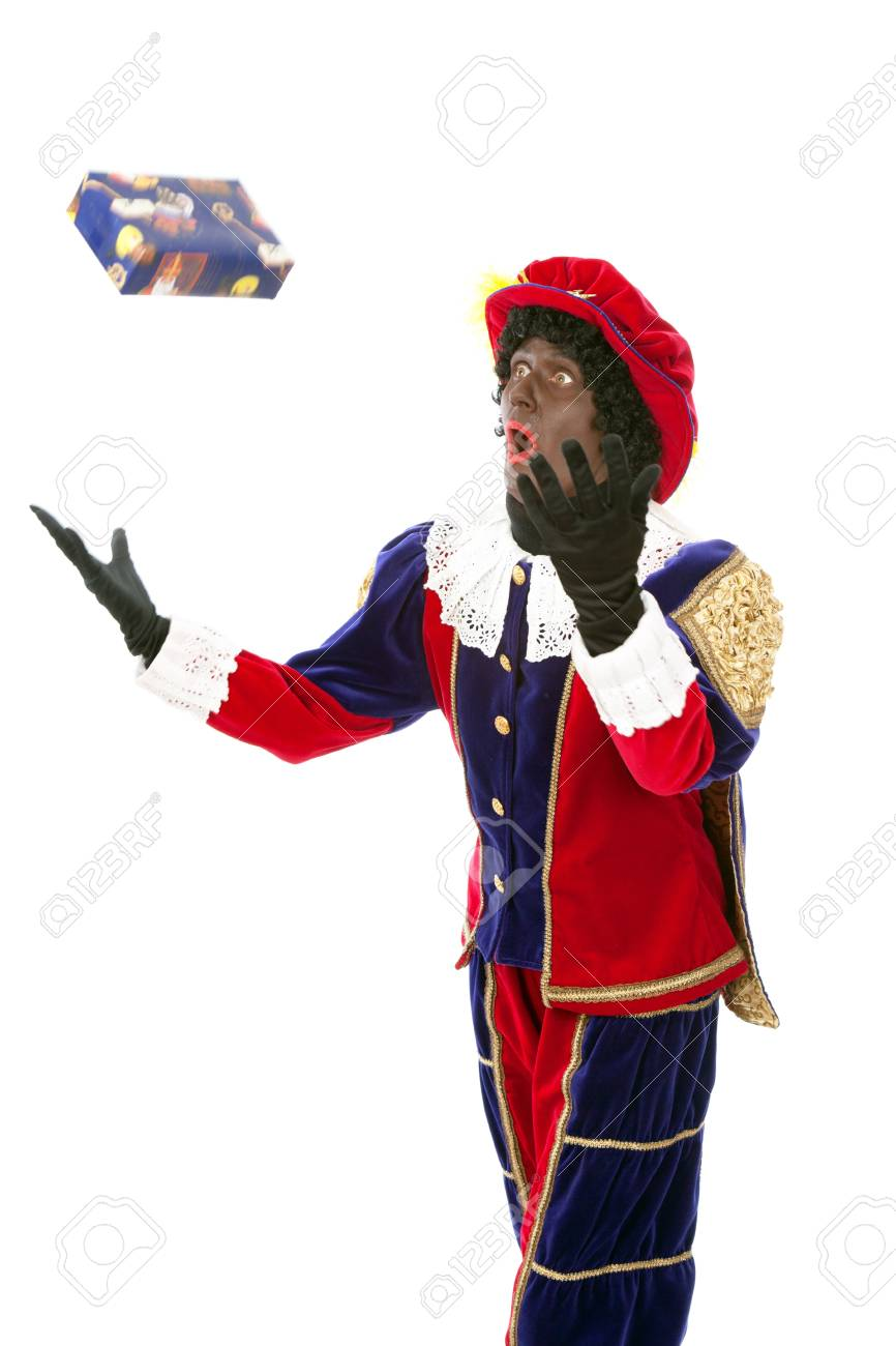 Zwarte piet   black pete  typical Dutch character part of a traditional event celebrating the birthday of Sinterklaas in december over white background Stock Photo - 18208858