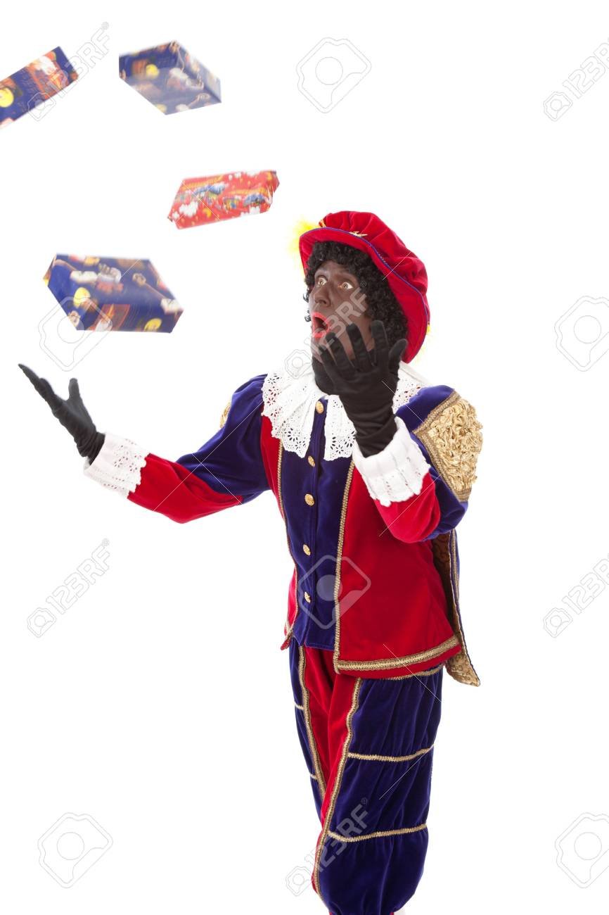 Zwarte piet   black pete  typical Dutch character part of a traditional event celebrating the birthday of Sinterklaas in december over white background Stock Photo - 18208856