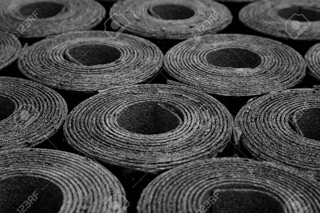 Closeup of Rolls of new black roofing felt or bitumen - 33813107