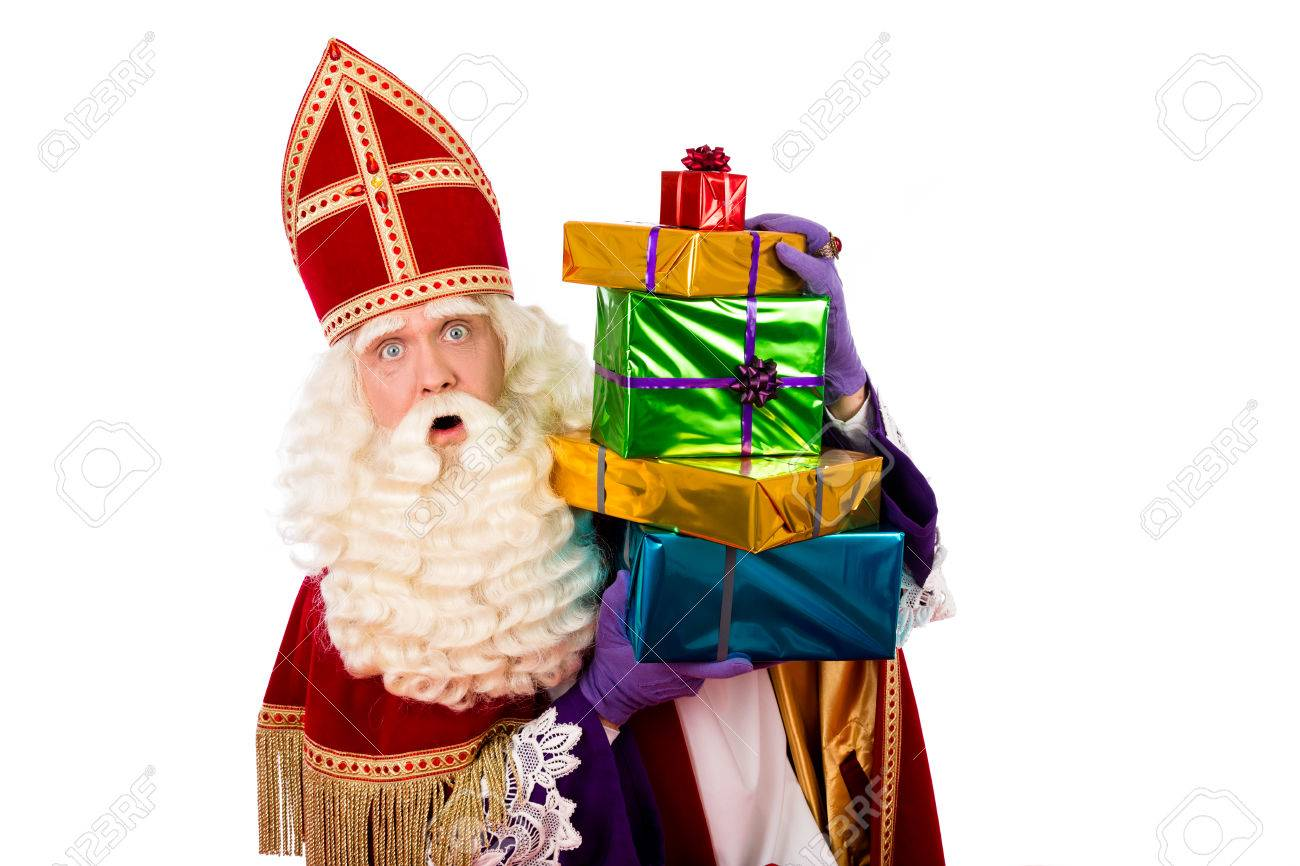 sinterklaas with gifts . typical Dutch character part of a traditional event celebrating the birthday of Sinterklaas (Santa Claus) in december. - 44127170