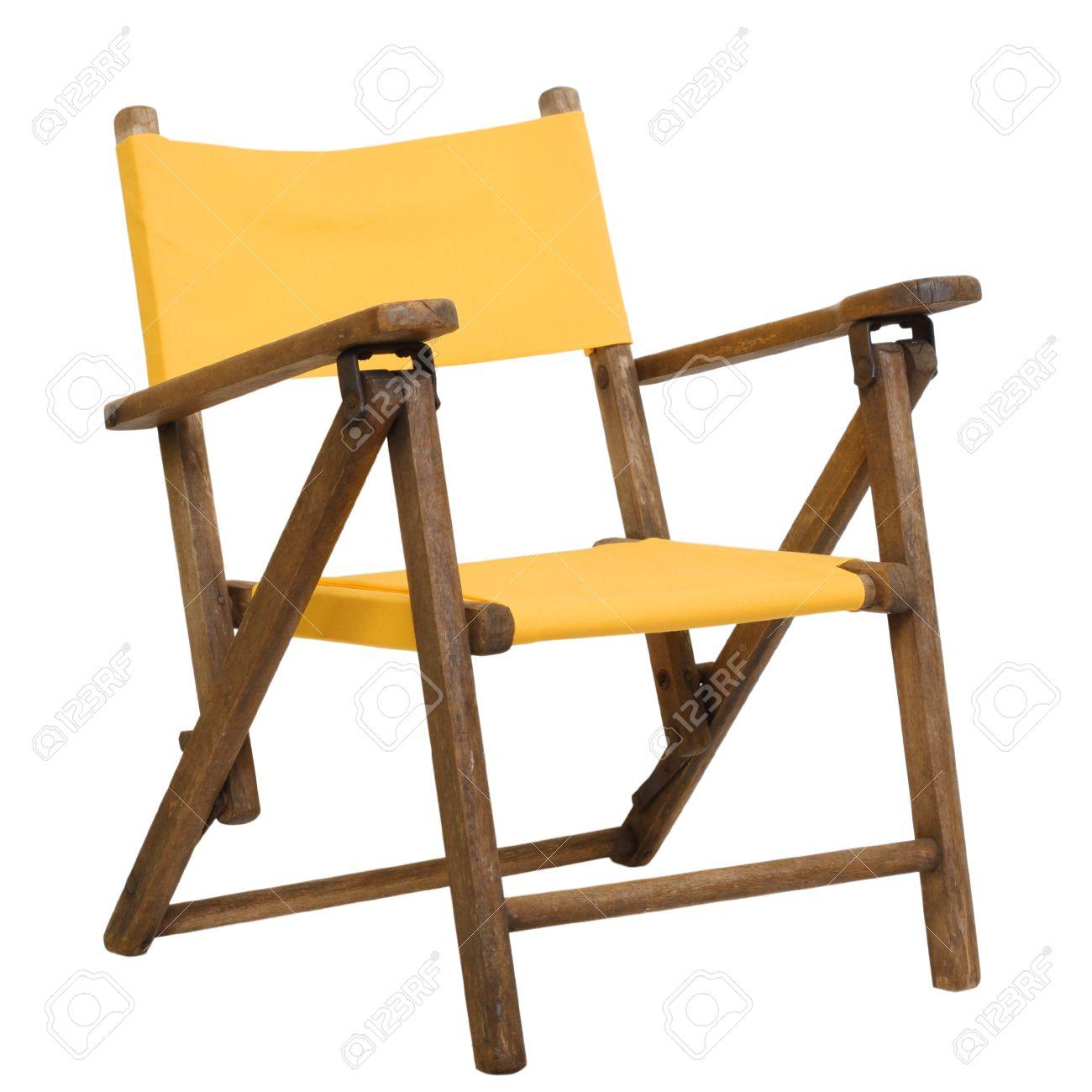 antiguos nios lona plegable silla plegable en color amarillo brillante foto de archivo