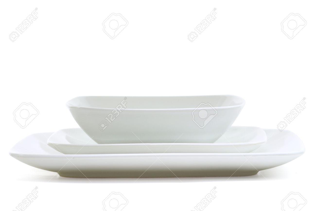 Set of white square dinner plates on white Stock Photo - 17723911  sc 1 st  123RF.com & Set Of White Square Dinner Plates On White Stock Photo Picture And ...