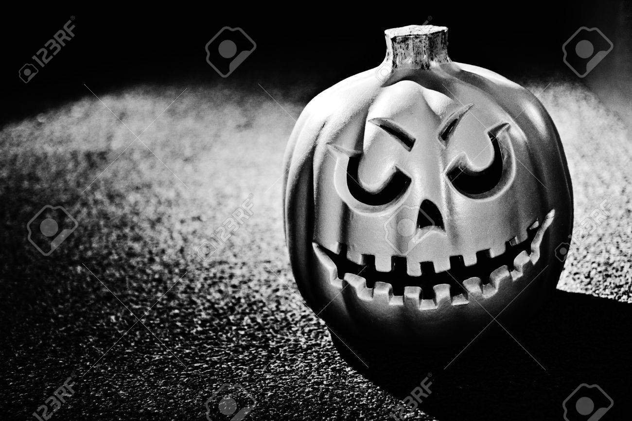 Black and white photo of a pumpkin with dramatic lighting stock photo 14945161
