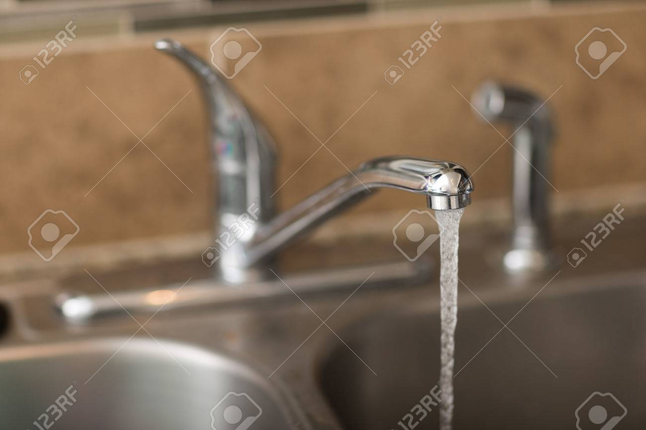 Water Coming Out Of A Faucet. View Is A 3/4 View With Shallow ...