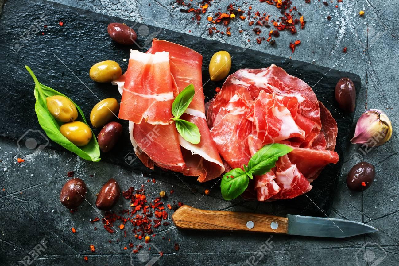 Smoked Parma ham on the black board - 88997051