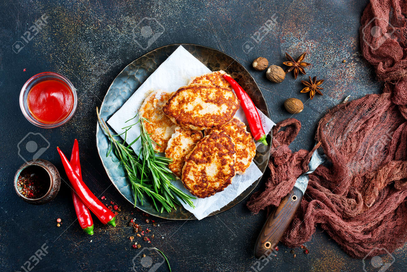 fried cutlets with sauce, chicken cutlets on plate - 123144386