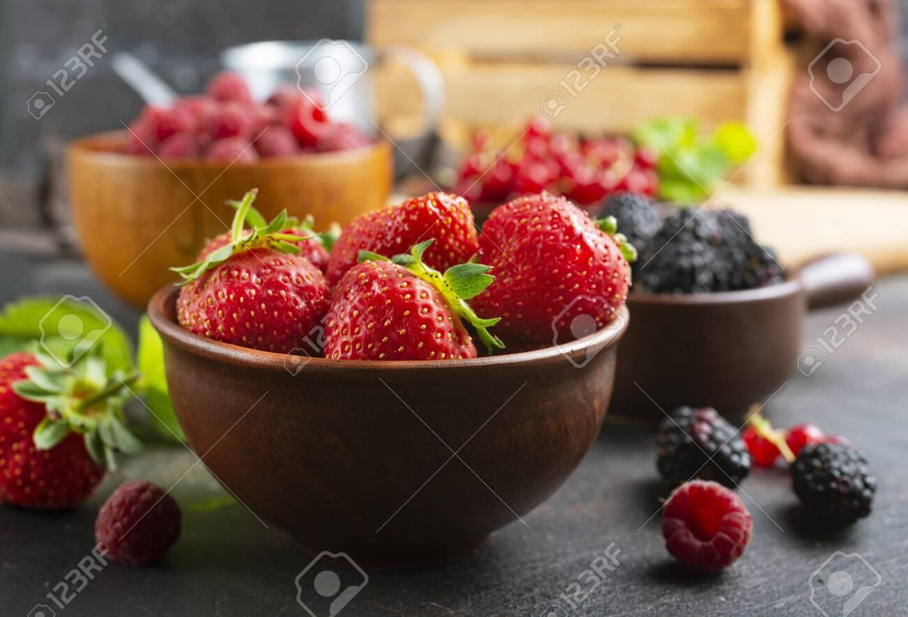 Various fresh summer berries, ripe strawberries, raspberries, blackberry - 128851538