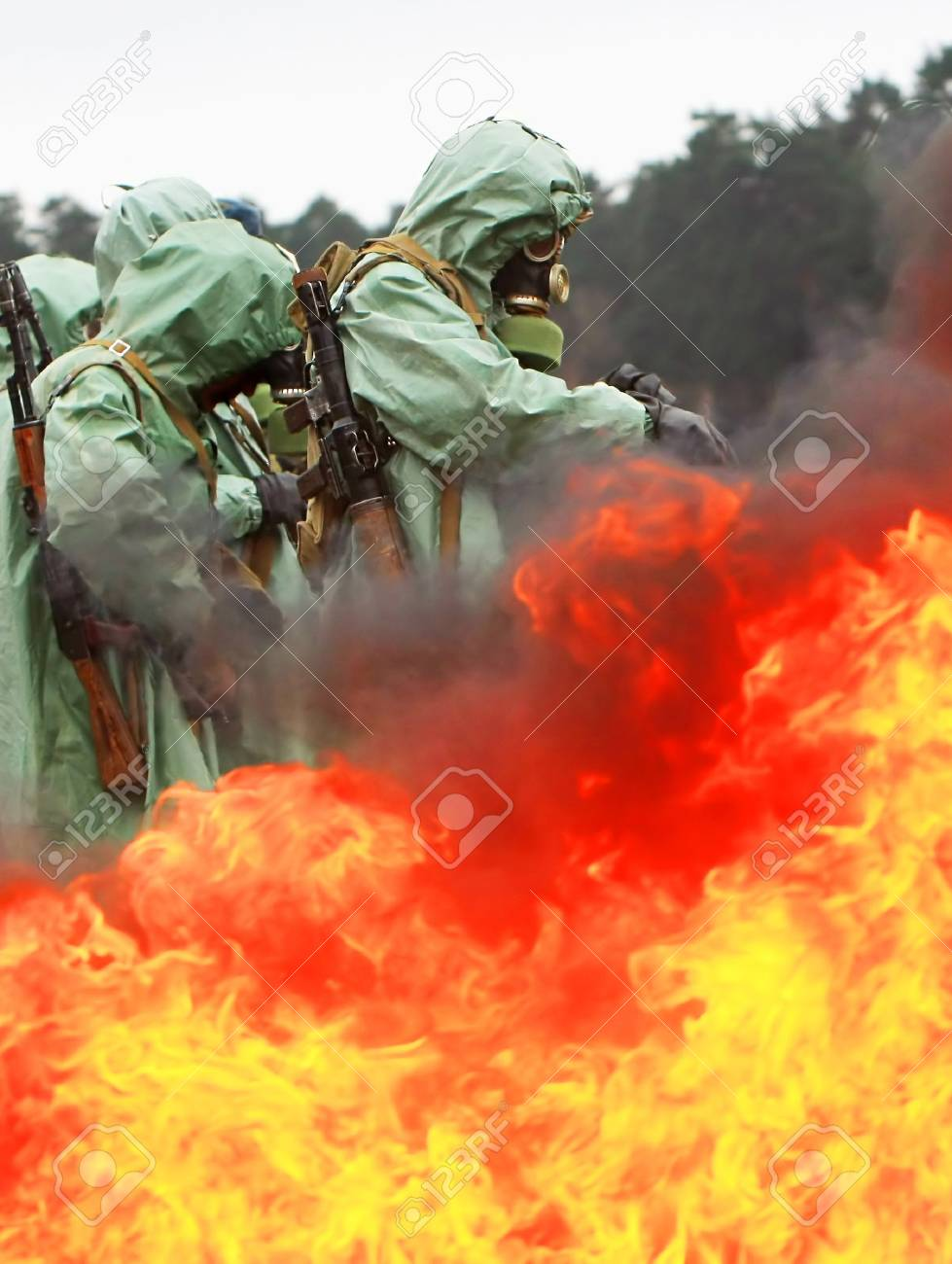 soldiers dress chemical protection suites. Stock Photo - 4382236