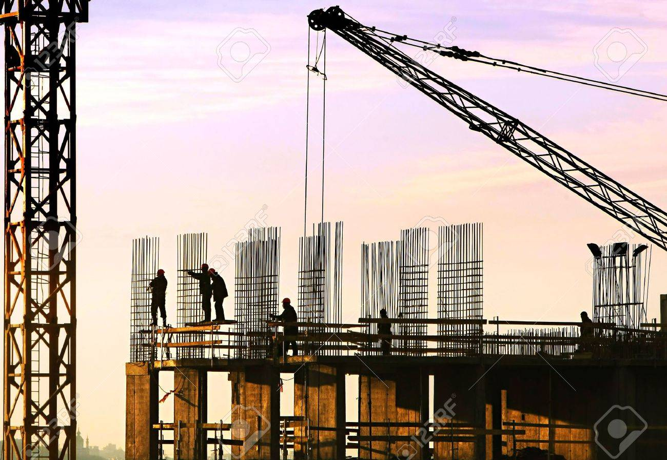 Silhouette of construction workers Stock Photo - 4717629