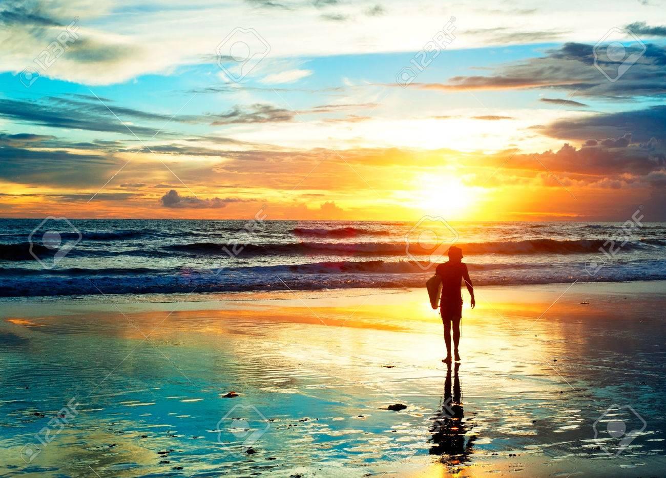 Surfer walking on the beach in sunset light. Bali island, Indonesia - 33067098