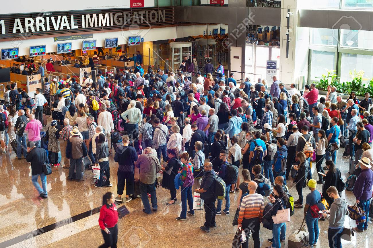 SINGAPORE - JAN 13, 2017: People waiting in queue at arrival immigration of Changi airport. Changi International Airport serves more than 100 airlines operating 6,100 weekly flights. - 72722850