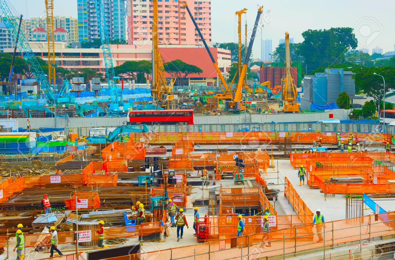 Workers in uniform at urban construction site. Singapore - 109936021