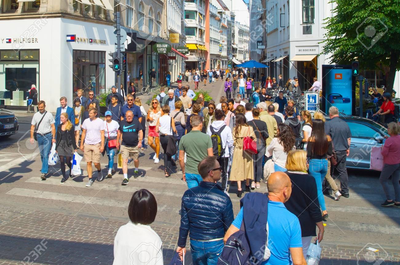 52bb7e6c COPENHAGEN, DENMARK - JUNE 14, 2018: People crossing the road at Copenhagen  central