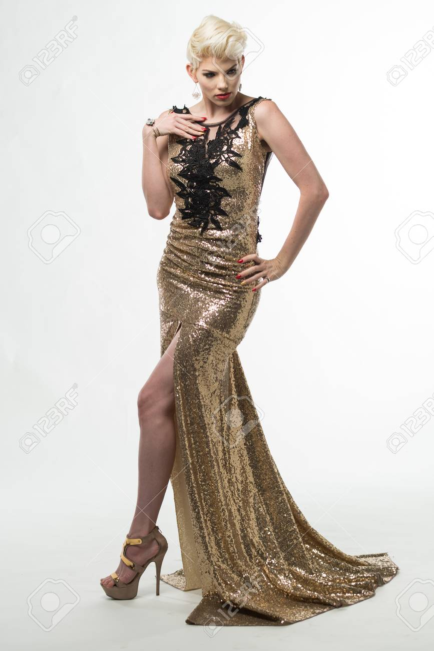 Beautiful Woman In Gold Gown On White Backdrop Stock Photo, Picture ...