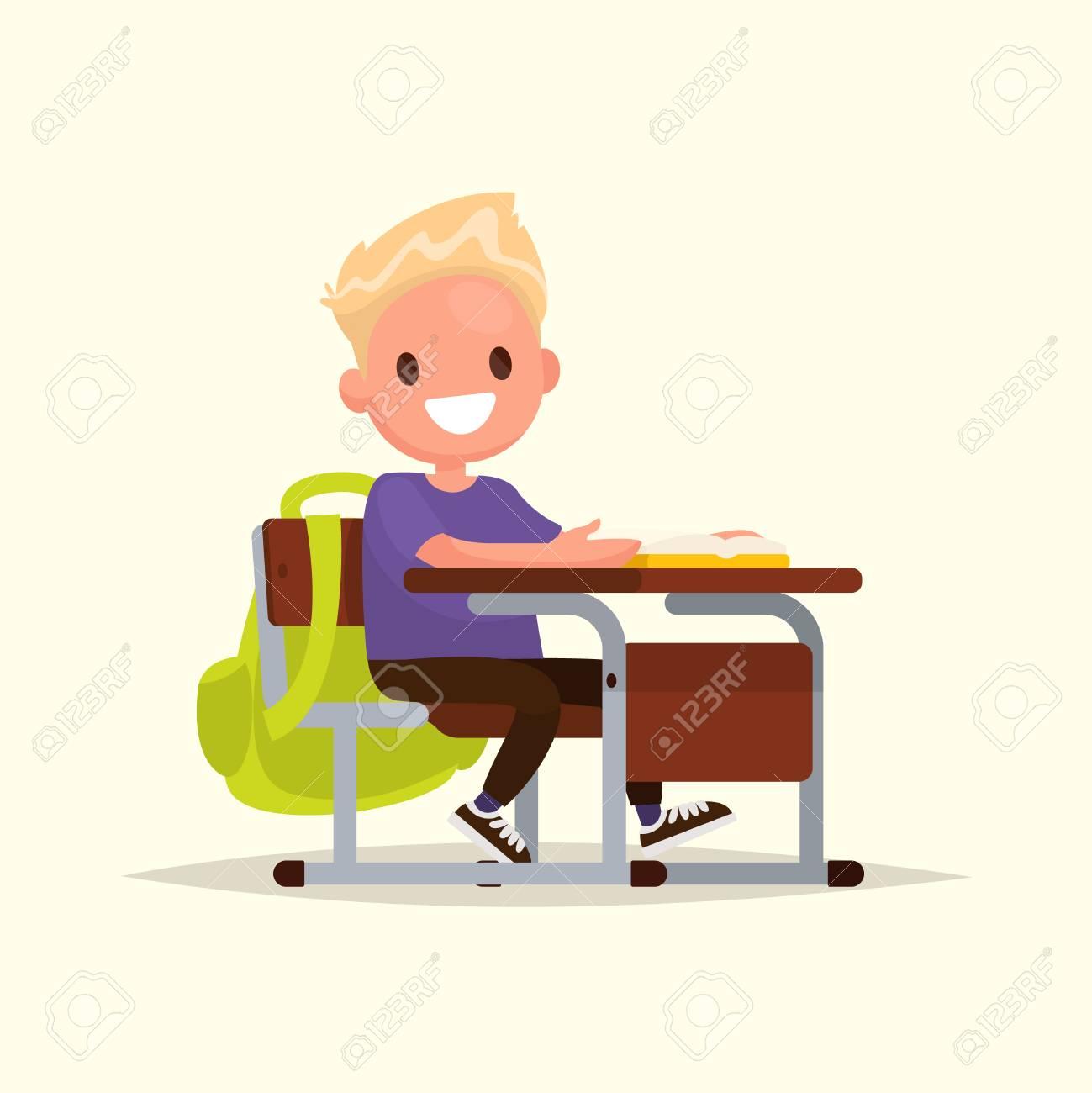 Schüler Der Grundschule Der Schüler Sitzt An Einem Schreibtisch