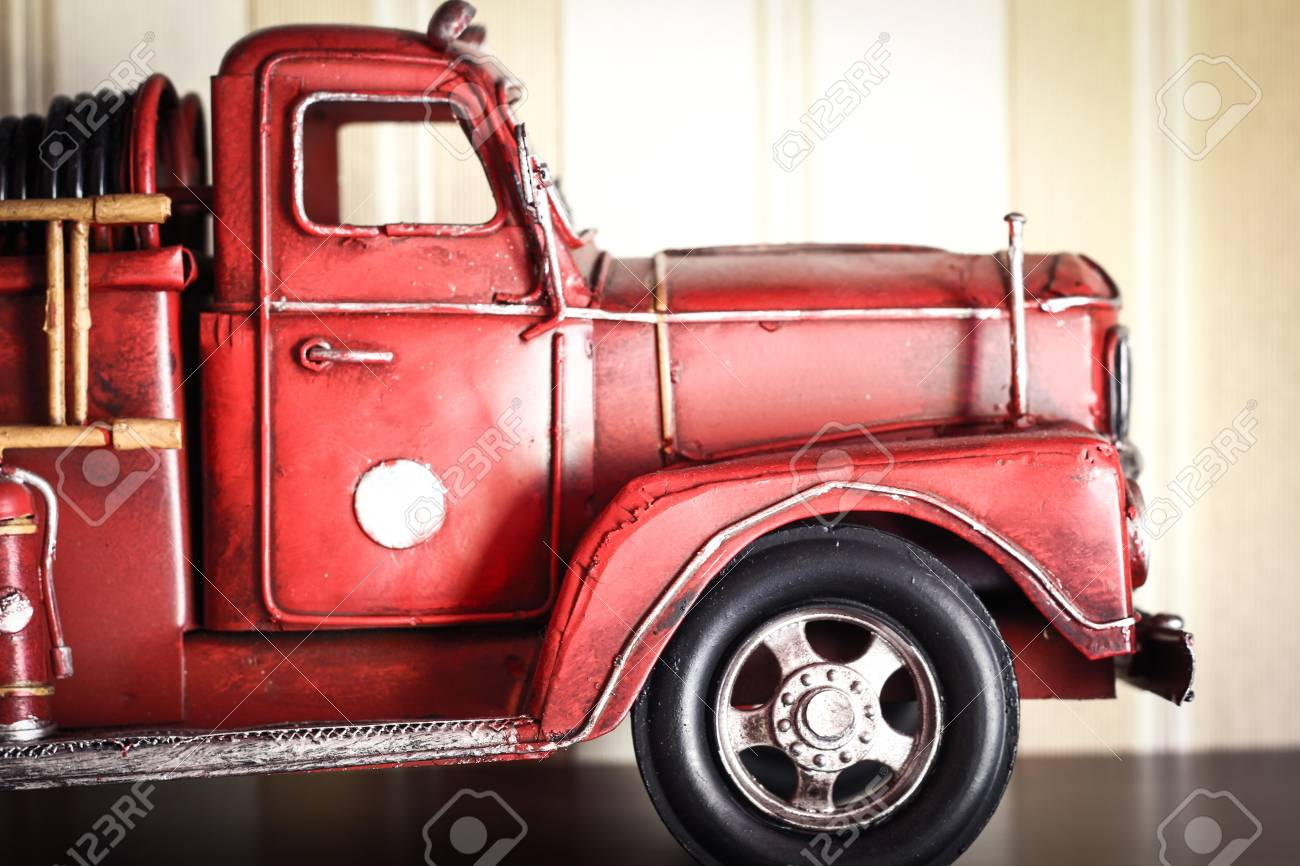 Car Plastic Model Of An Old Classic Red Fire Truck On A Stripped ...