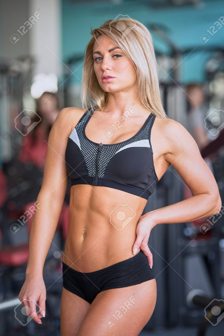 Fit Beautiful Blond Girl With Abs In A Black Shorts And Black Stock Photo Picture And Royalty Free Image Image 98144222