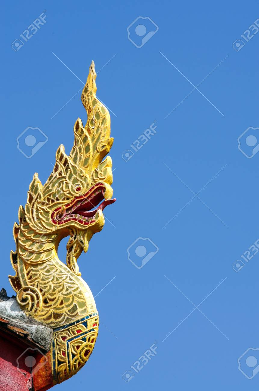Serpent on Roof tiles in blue sky background Stock Photo - 17547006