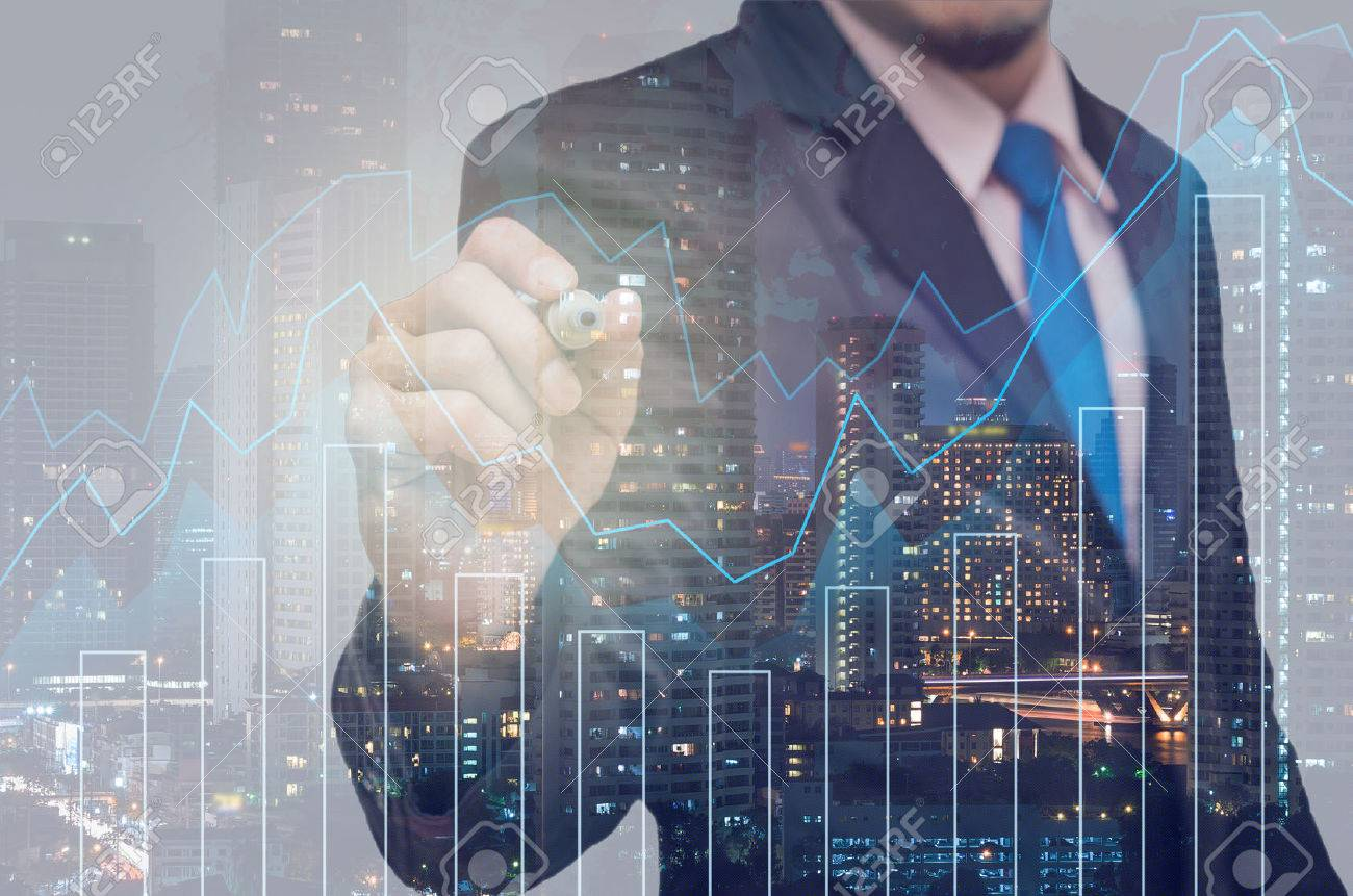 Double exposure of businessman with Trading graph on the cityscape background,Business financial concept - 50038567