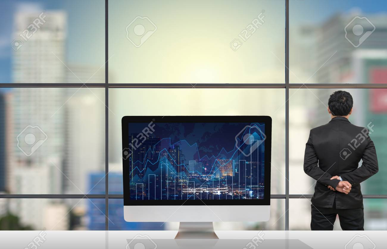 Back side of businessman looking at citiy out off windows glass back side of businessman looking at citiy out off windows glass with computer show trading graph gumiabroncs Image collections