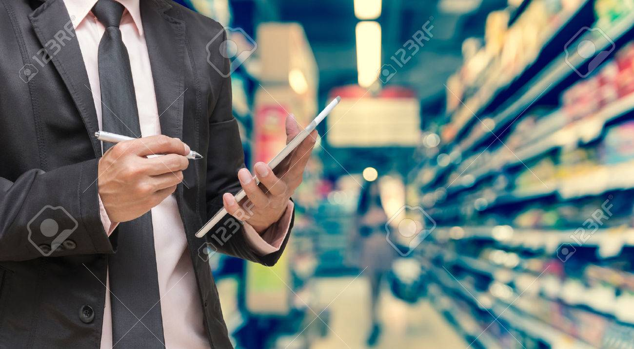 Businessman using the tablet on Abstract blurred photo of store in department store bokeh background, business shopping concept - 57754798