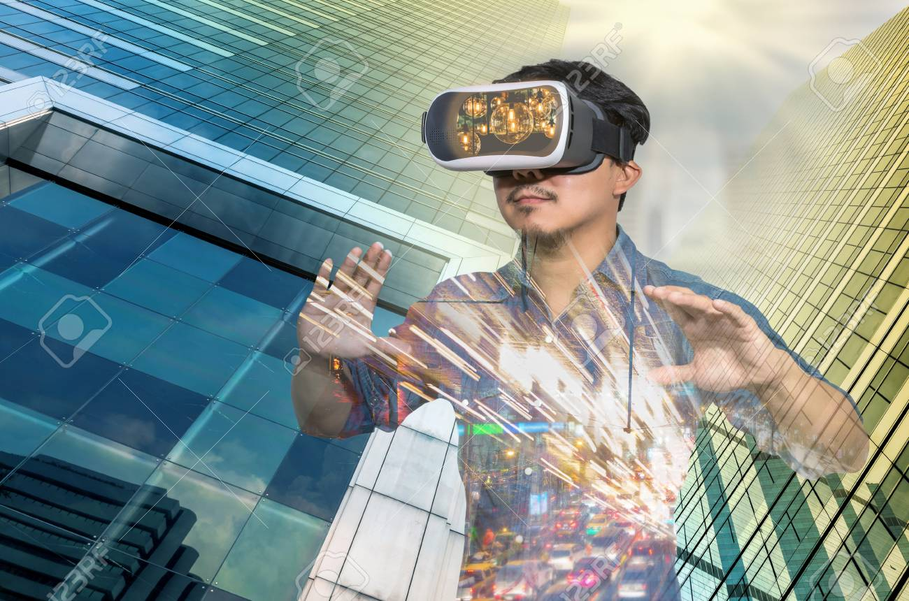 Double exposure of Asian man wearing virtual reality over the Modern business building glass of skyscrapers background, VR with business building concept - 64396869