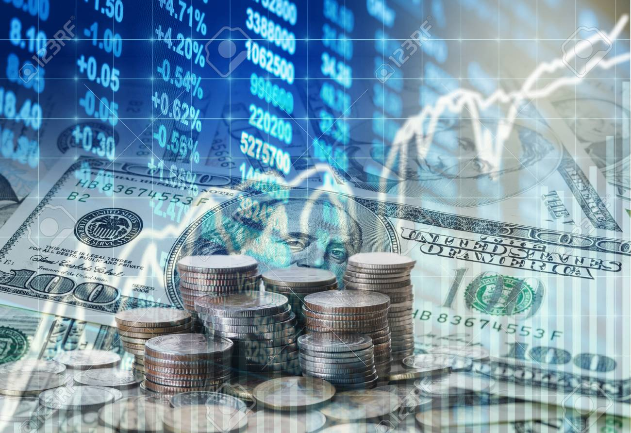 Stack of coins and american dollars money over the LED display Stock market exchange data background, Business investment and trading concept - 66134065