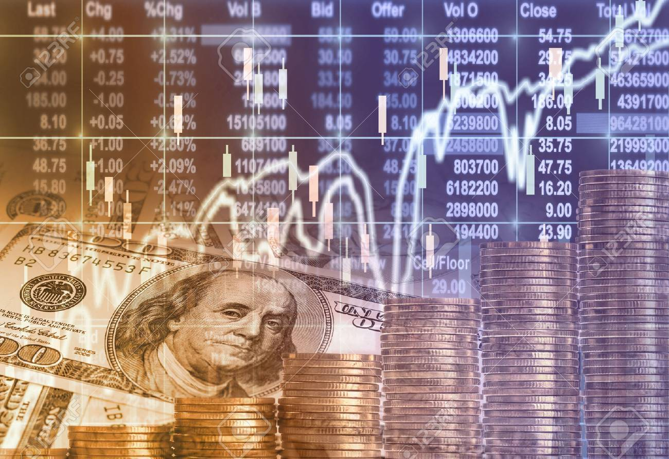 Stack of gold coins and american dollars money over the LED display Stock market exchange data background, Business investment and trading concept - 66136312