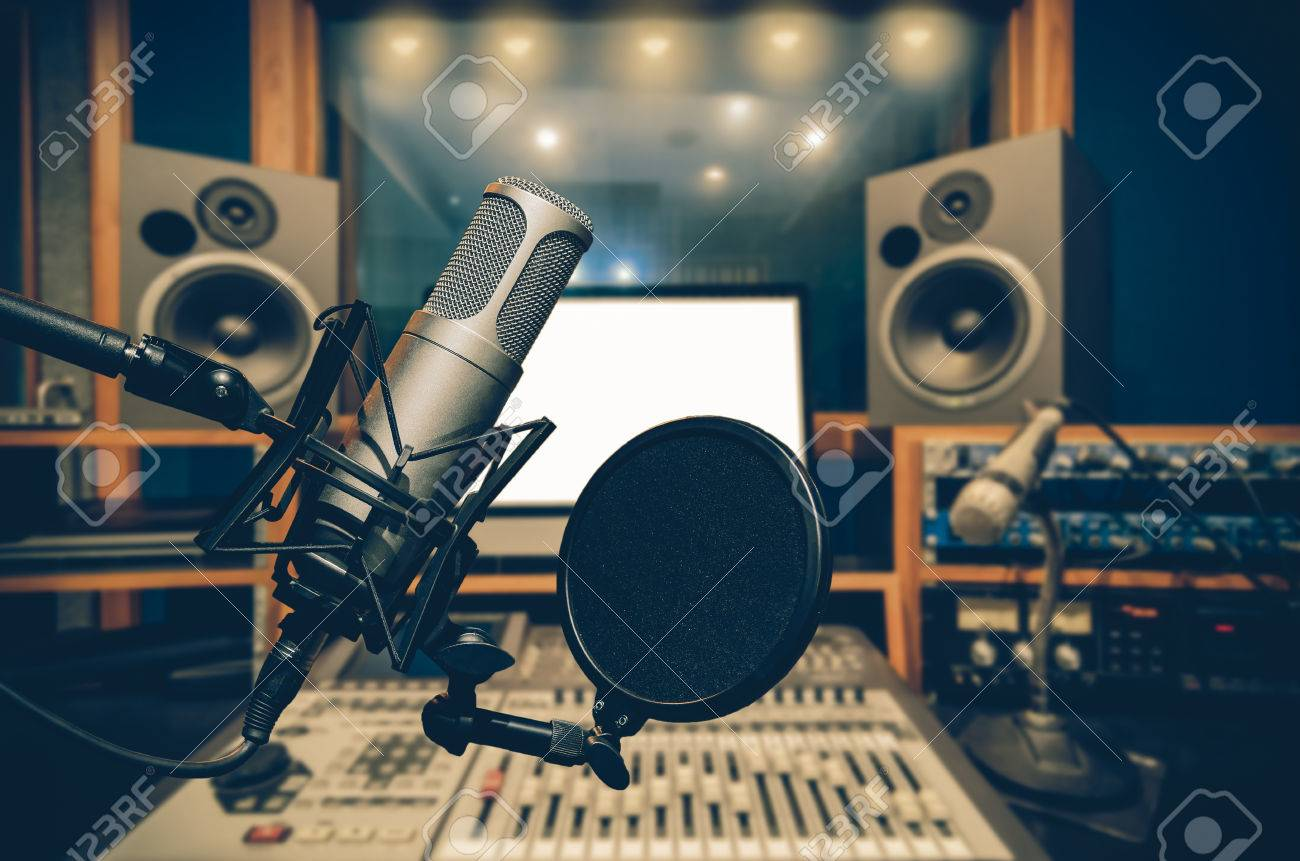 Professional condenser studio microphone over the abstract photo blurred of music studio background, Musical instrument Concept - 66206623