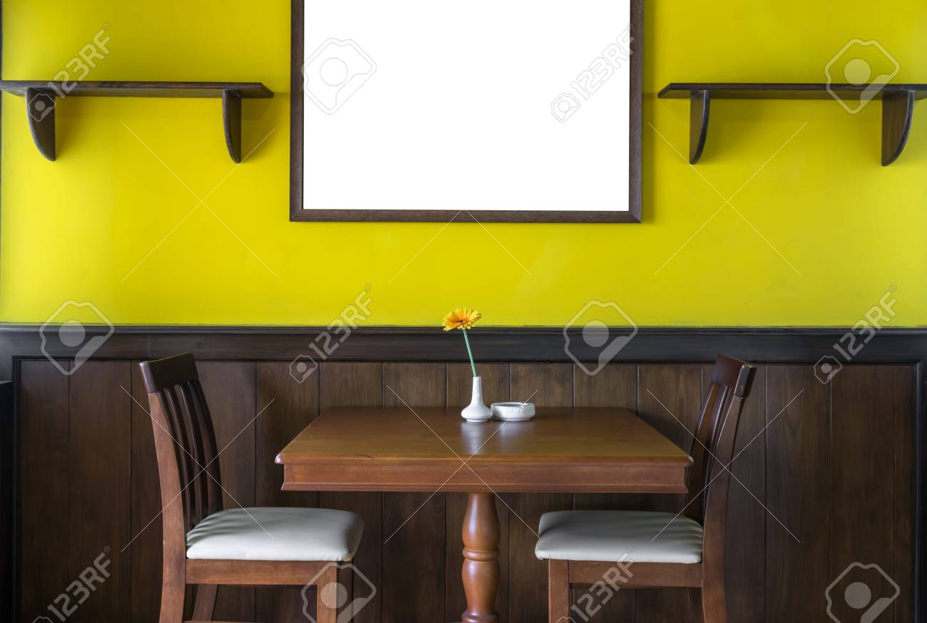 Luxury Restaurant Set With Yellow Color Wall With Big Photo Frame Stock Photo Picture And Royalty Free Image Image 67767644