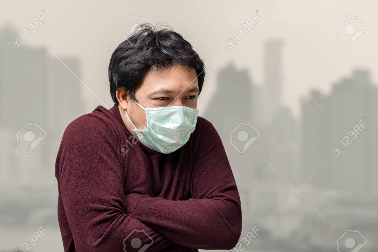 Against Asian Face With The Cold Wearing Pollution Mask Man Air