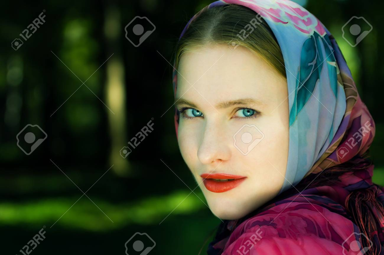 Pretty smiling blond woman with blue eyes Stock Photo - 5654220