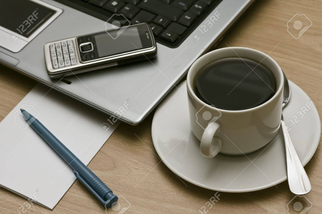 business communications - laptop, cell mobile phone  and cup of coffee on a desktop Stock Photo - 5984885