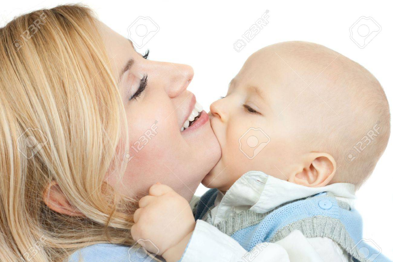 happy family: cute little boy kissing his mother - isolated on white background Stock Photo - 6435935