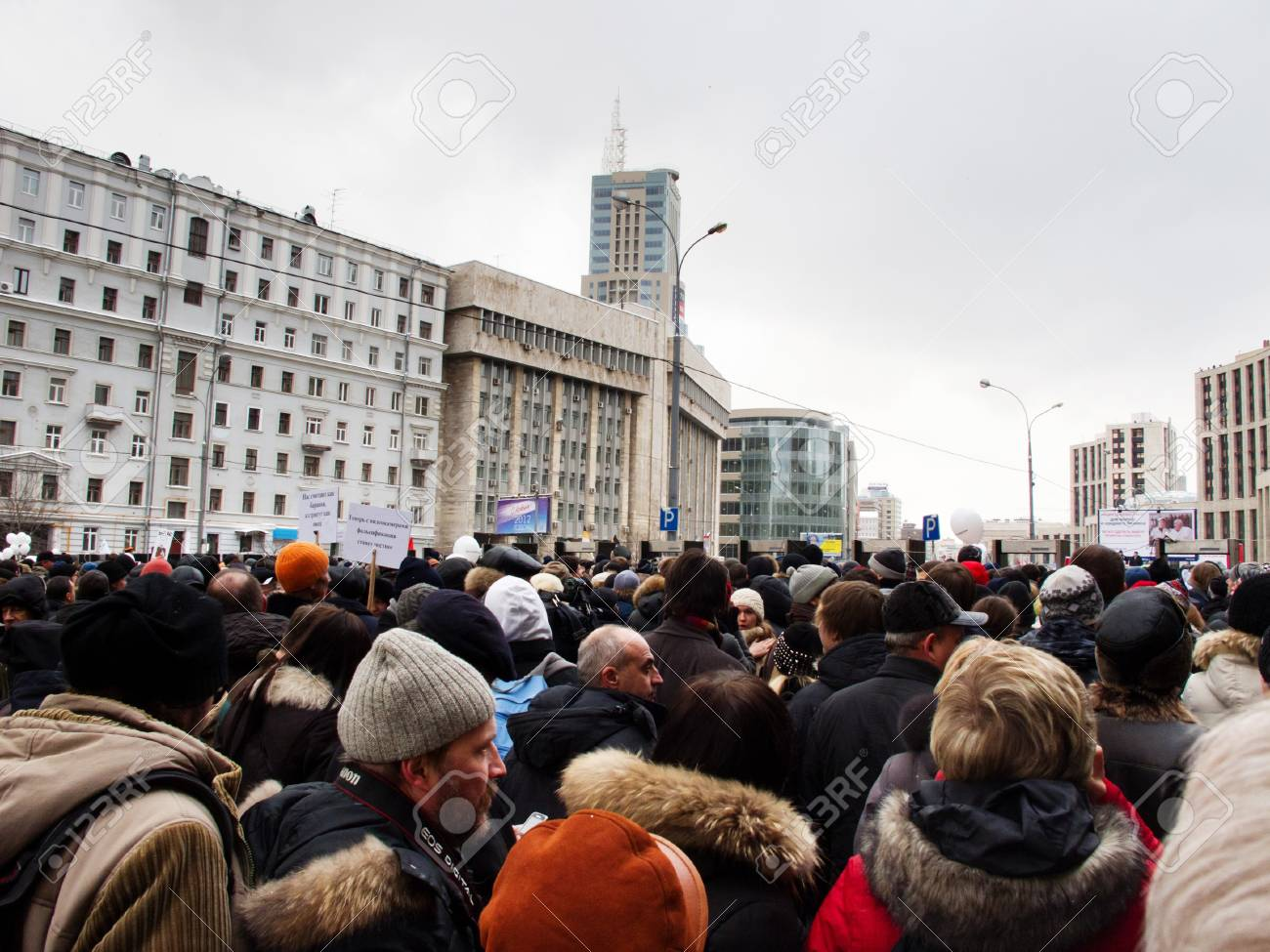 MOSCOW, RUSSIA - DECEMBER, 24, 2011: Participants of the protest manifestation on the Saharov square in Moscow. People remonstrate against falsification of the parliamentary election results. DECEMBER, 24, 2011 IN MOSCOW, RUSSIA Stock Photo - 11653894