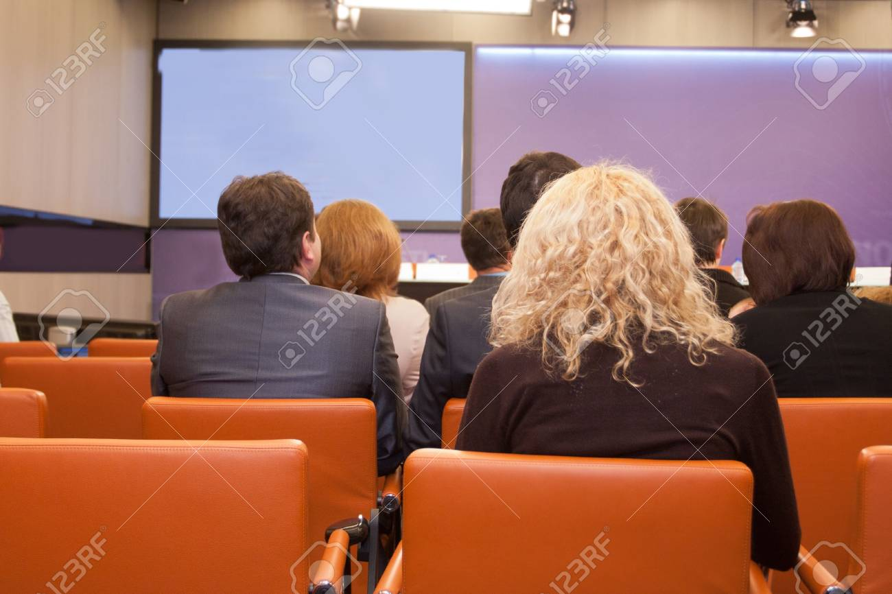 The audience listens to the acting in a conference hall. Stock Photo - 12618116