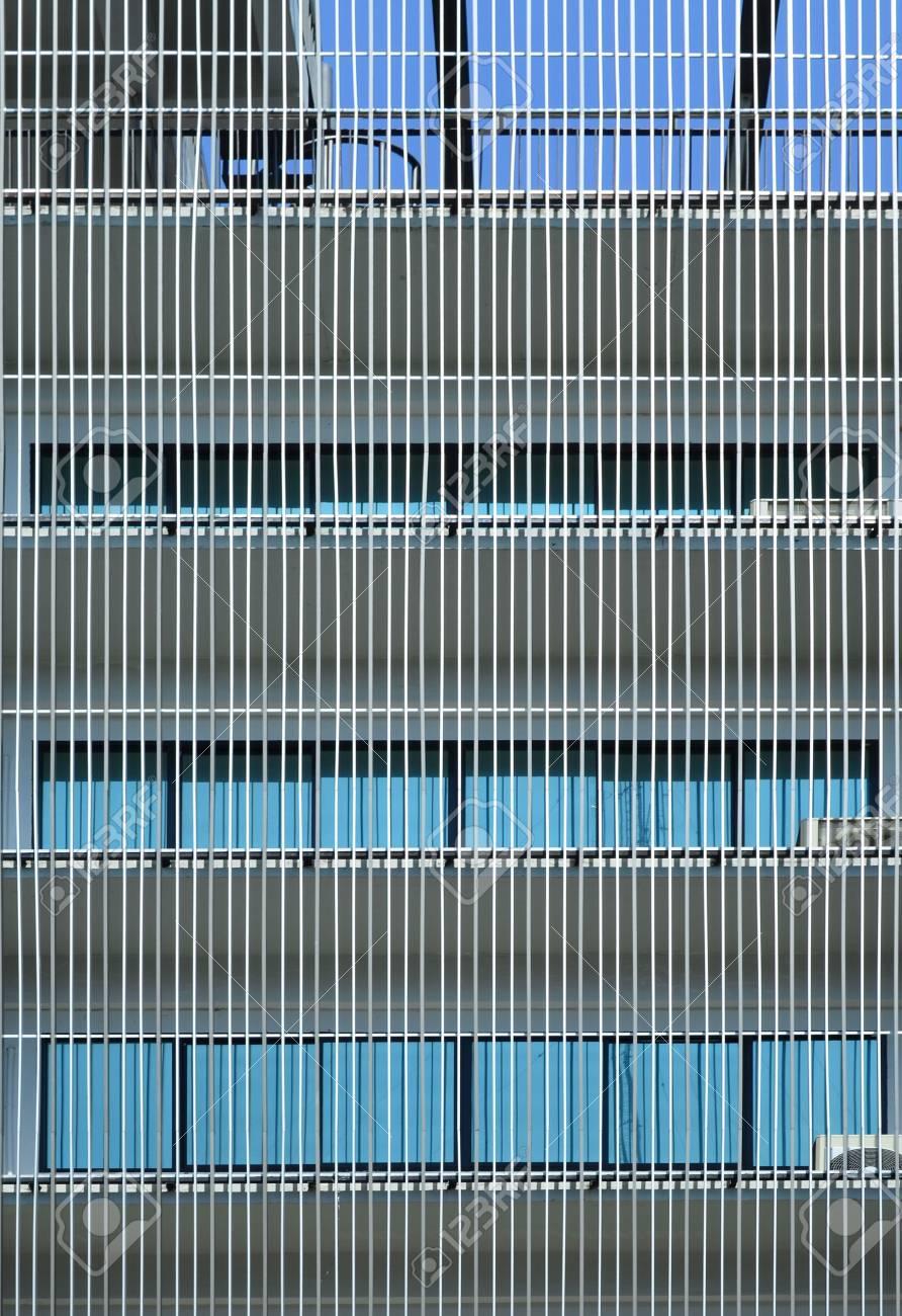Metal batten facade in front of modern building stock photo 61073067