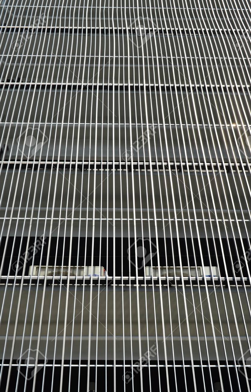 Metal batten facade in front of modern building stock photo 61073263