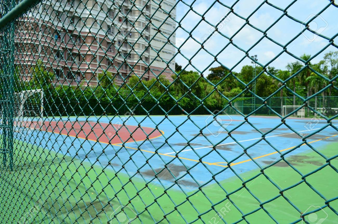 Wire Mesh Fence With Football Field Background Stock Photo, Picture ...